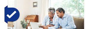 woman and man looking at laptop